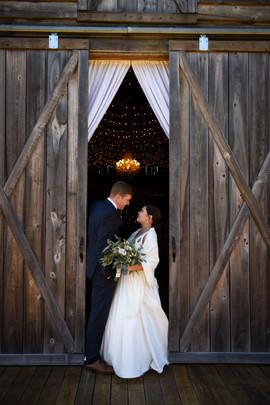 Megan & Grant in front of barn