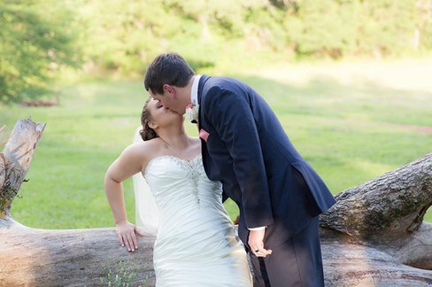 Kiss on fallen tree |The Wedding Barn at L'Horne