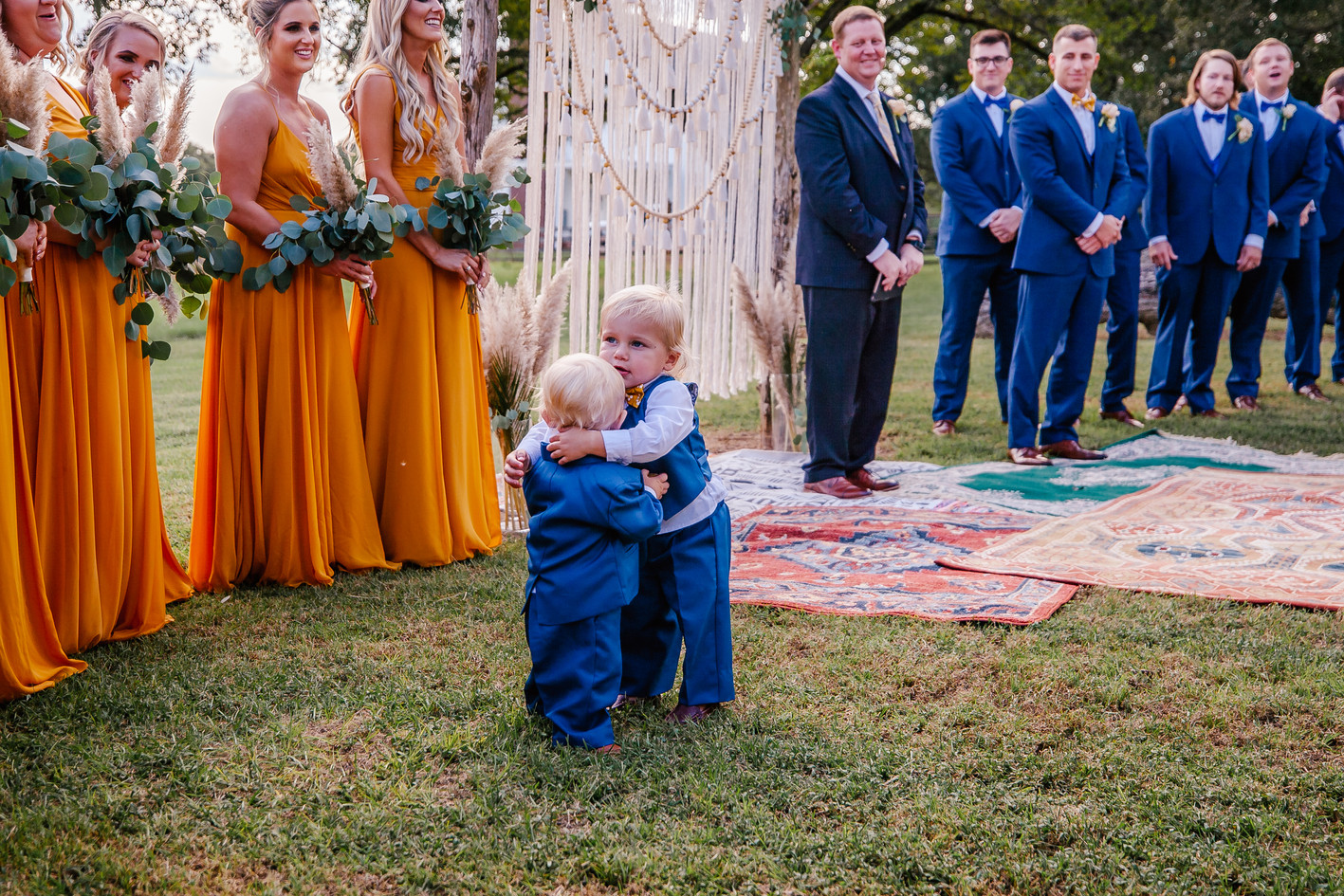 Dustin & Logan wedding party hug