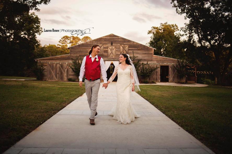 Amanda & Mry in front of new barn.jpg