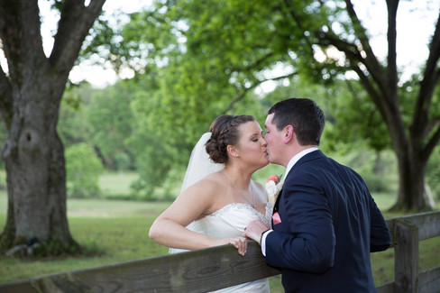 Kiss over fence |The Wedding Barn at L'Horne