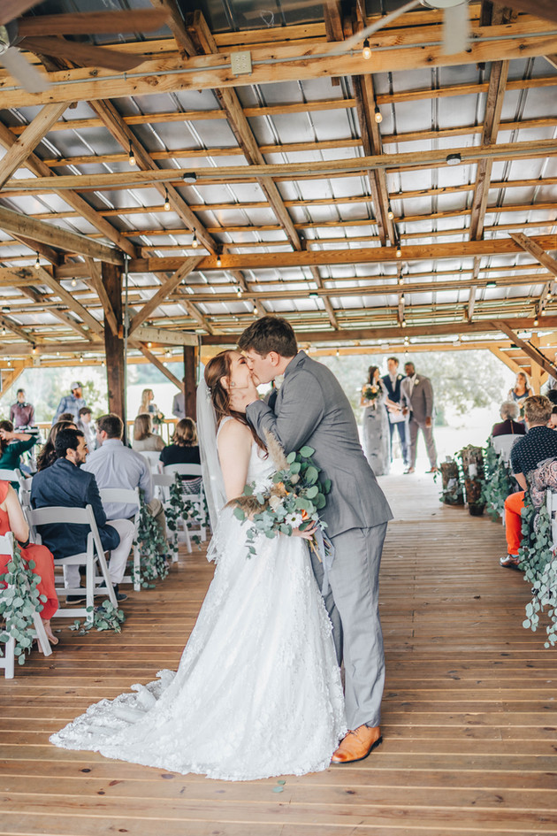 Janna & Ethan kiss walking down the aisle