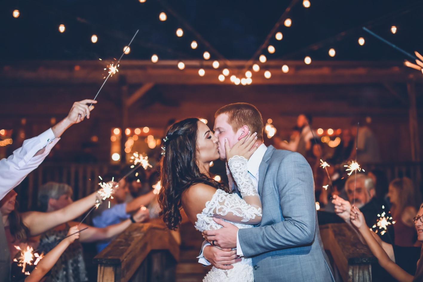 sparkler sendoff kiss on bridge