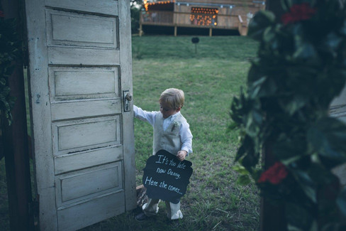 Son with sign |The Wedding Barn at L'Horne