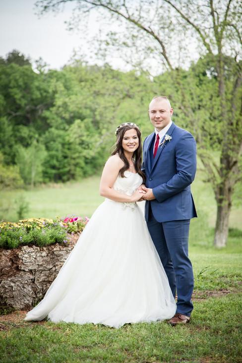 Sarah & Austin by flower tree.jpg