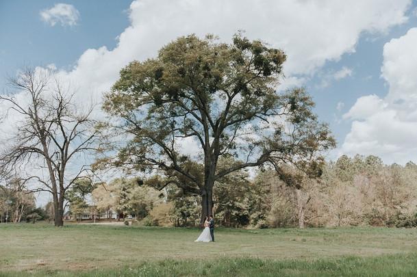 Amanda & Adam in front of big tree.jpg