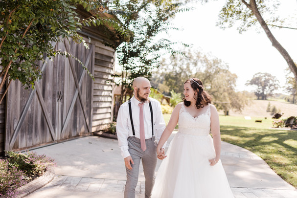 Clara & John in front of barn
