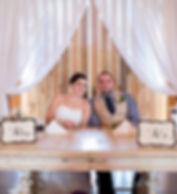 Nicole & Jacob at sweetheart table.jpg