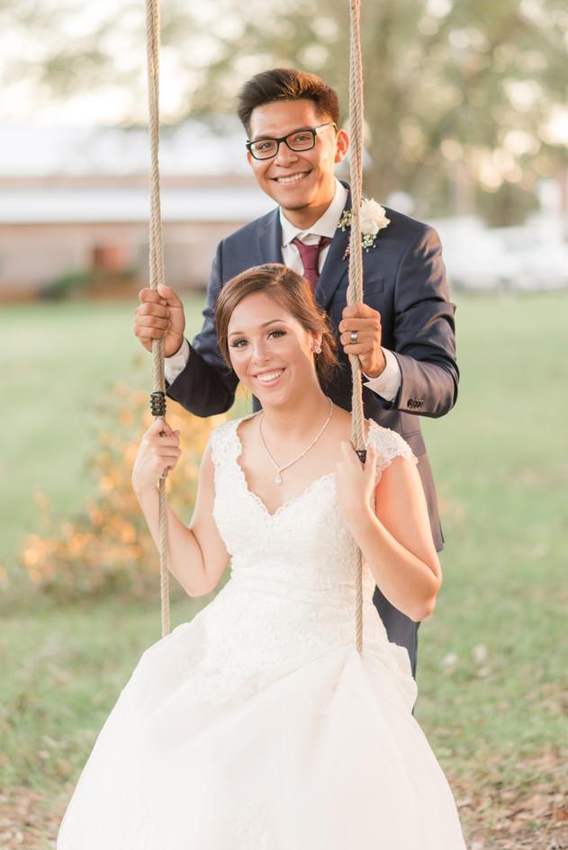 happy couple in tree swing