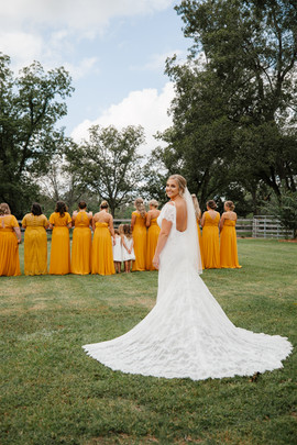 Logan first look with bridal party