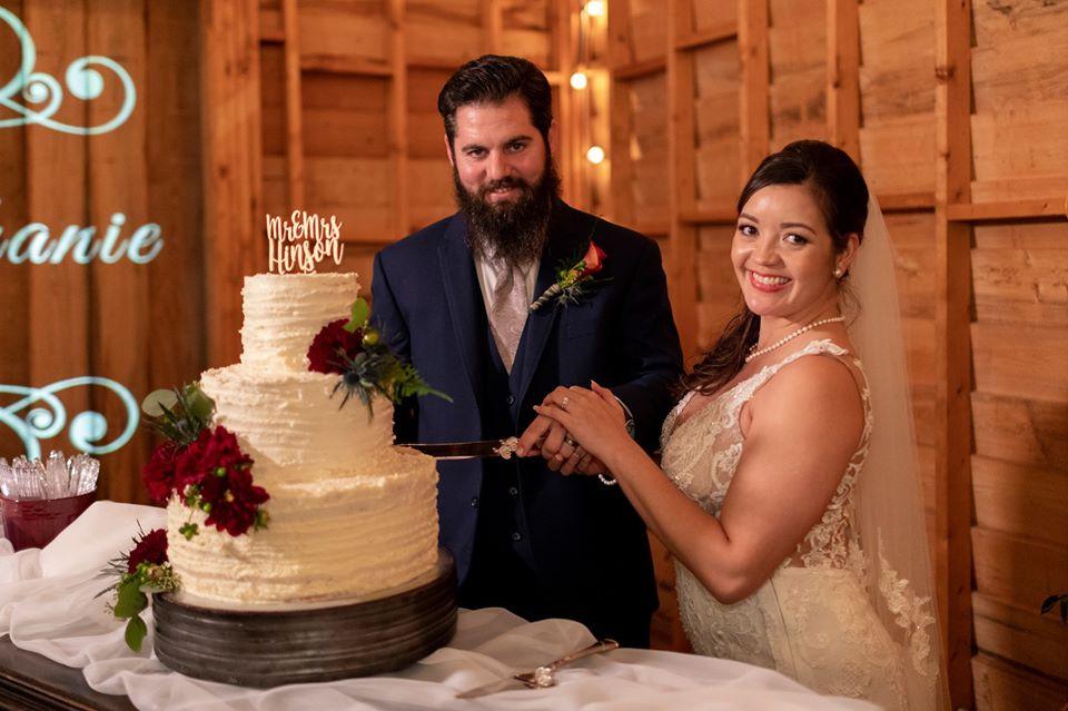 S&C cutting brides cake.jpg