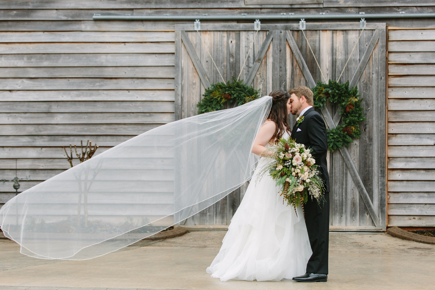 Kiss in front of grand barn
