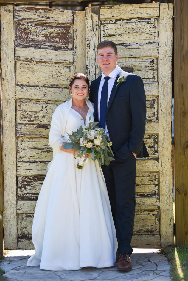 Megan & Grant in front of entry doors