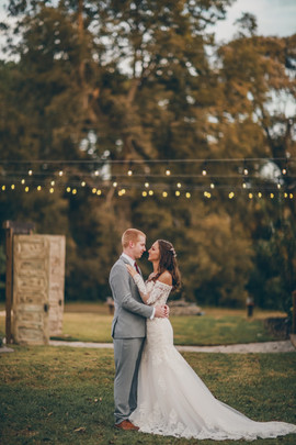 Mallory & Chase under string lights