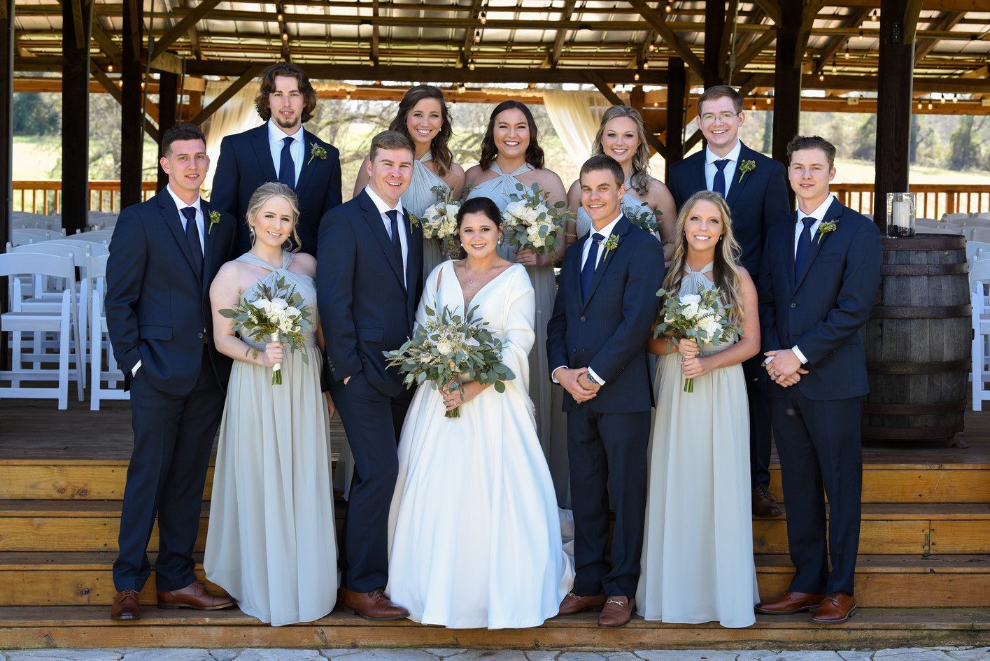 Wedding party on pole barn steps