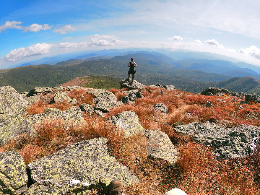 Mount Monroe Mountain In New Hampshire with Women Hiker Standing on It after summit