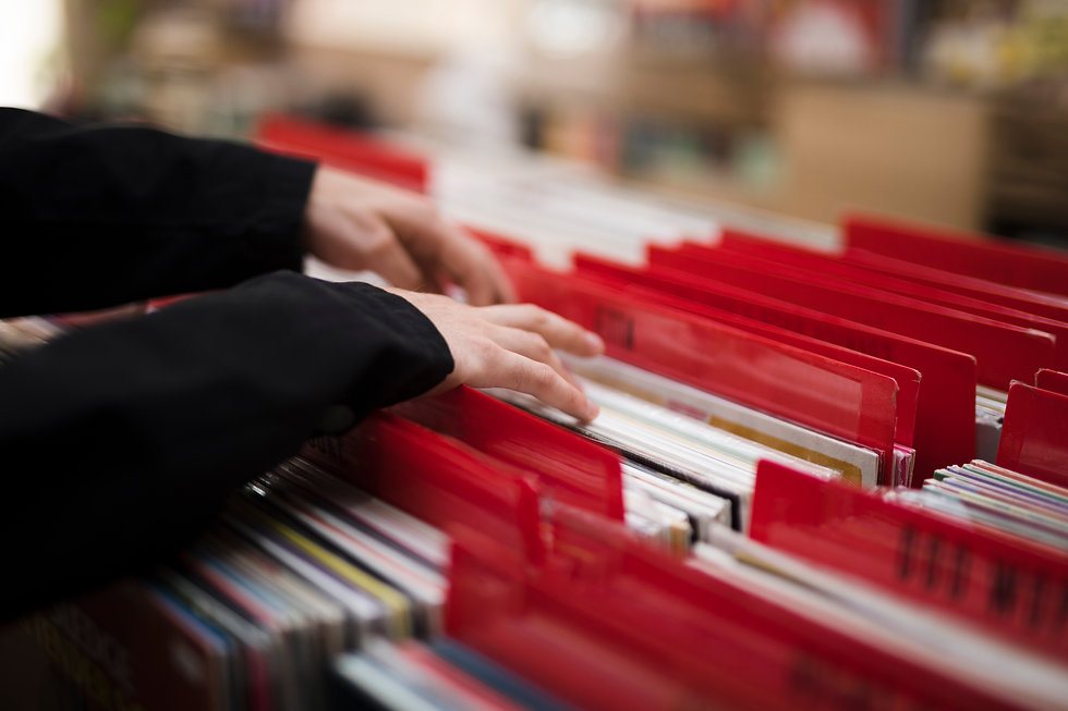 close-up-young-man-looking-for-vinyls-in