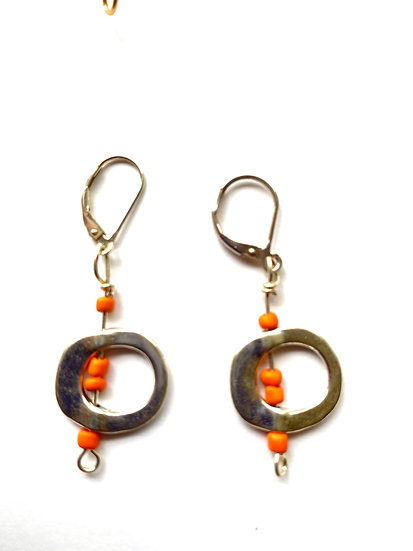 Silver circles with orange beads