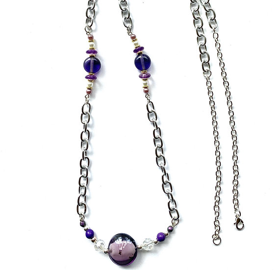 Purple glass stone with white accents