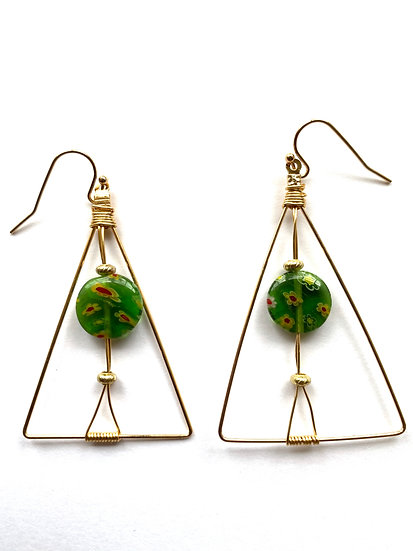 Green spotted stone in a triangle wire