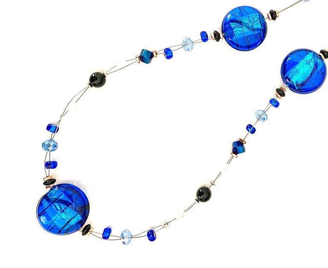Blue glass stone with white peral accents