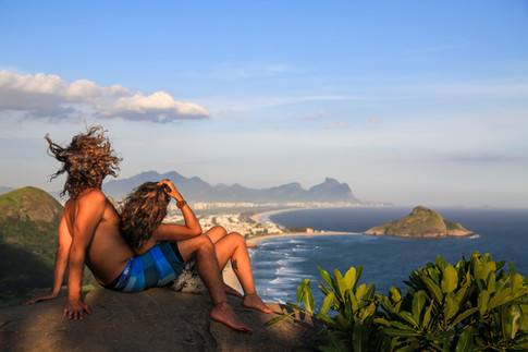 A couple contemplating the view from the top of Parque Natural Municipal da Prainha, Rio de Janeiro, Brazil. 2015