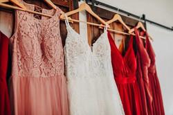 bridesmaids dresses hanging in Kansas city wedding venue @haleybphotography