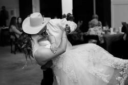 Bride and groom kissing at Kansas City wedding venue@haleybphotography