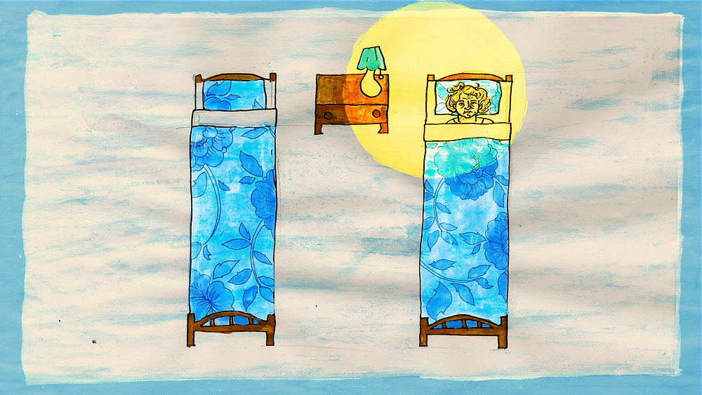Image shows still from animation. Two beds, with blue floral bed clothes, on a white, textured background with a blue border. One bed is empty, the other shows an elderly woman, illuminated by a circle of yellow light from the lamp on her bedside table, between the two beds.