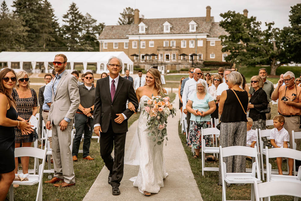 Bride and her father walking down the aisle at the Felt Estate in Holland, MI.