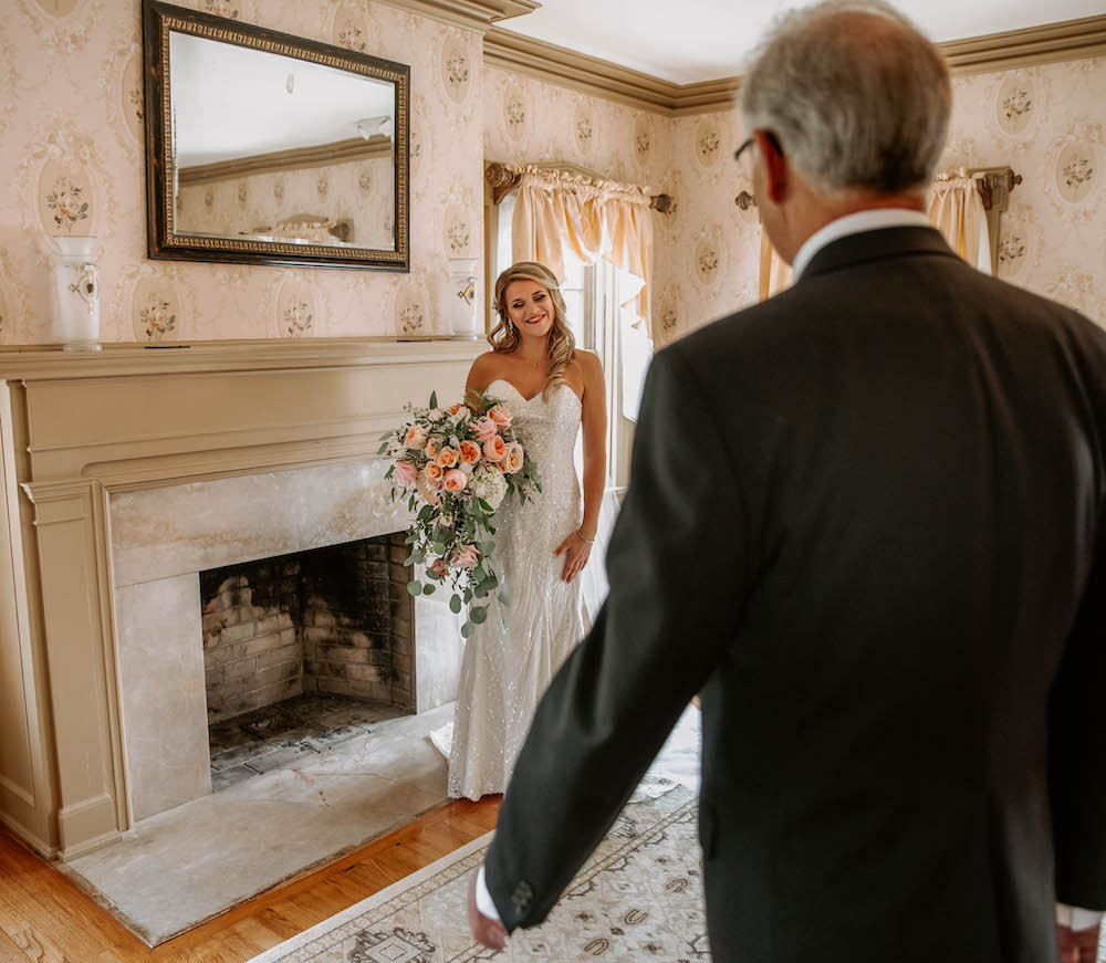 Bride's first look with her father at the Felt Estate in Holland, Michigan.