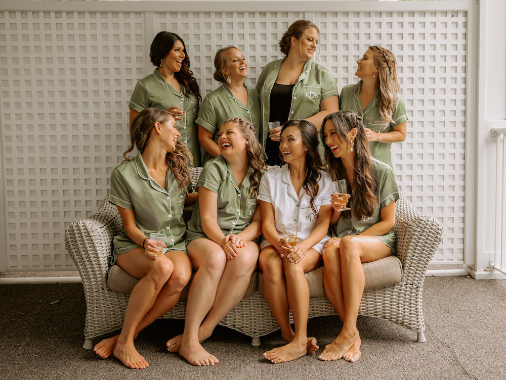 Bridal party getting ready photos in matching green pajamas.