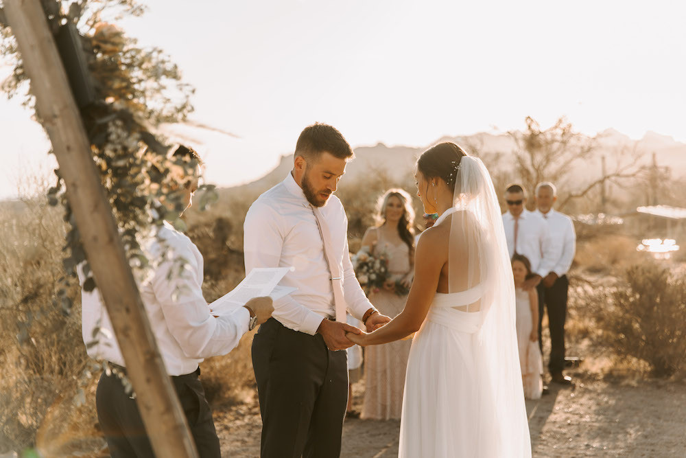 Bride and groom standing at the altar in the middle of the Arizona desert for their intimate elopement.
