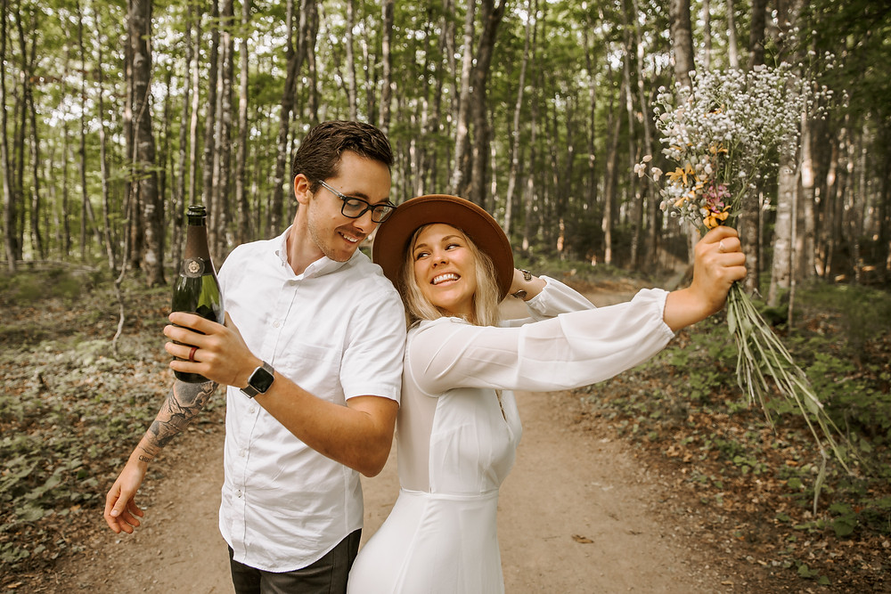Bride and groom on the Miners Falls trail in Michigan after their elopement.