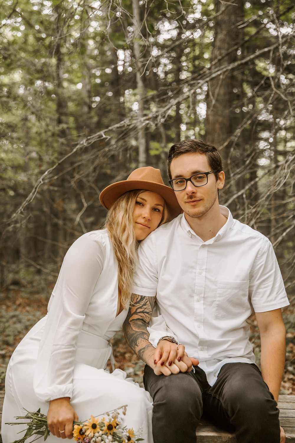 Bride and groom portraits in Miners Falls holding a wildflower bouquet.