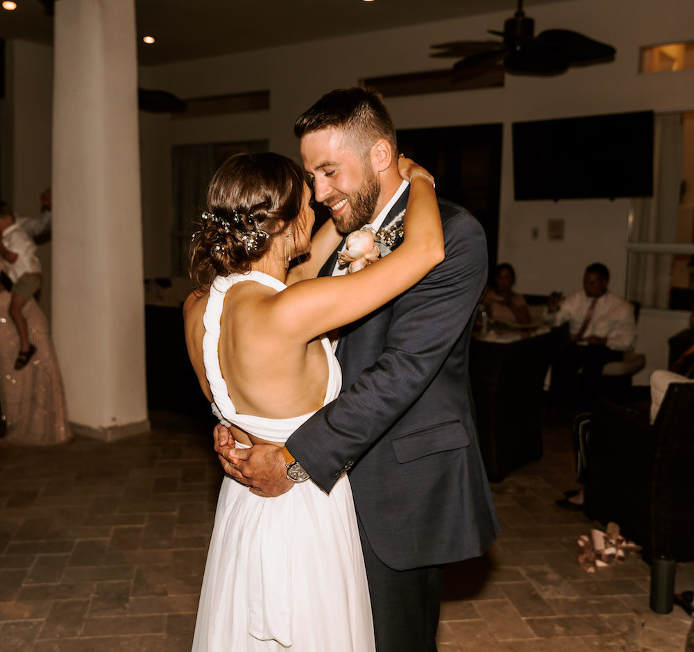 Bride and groom having their first dance in their Airbnb in Scottsdale, AZ after their elopement.