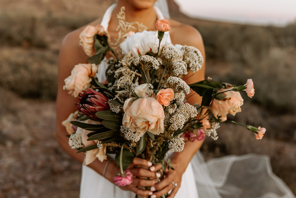 Pink and peach big bridal bouquet for an Arizona desert elopement.
