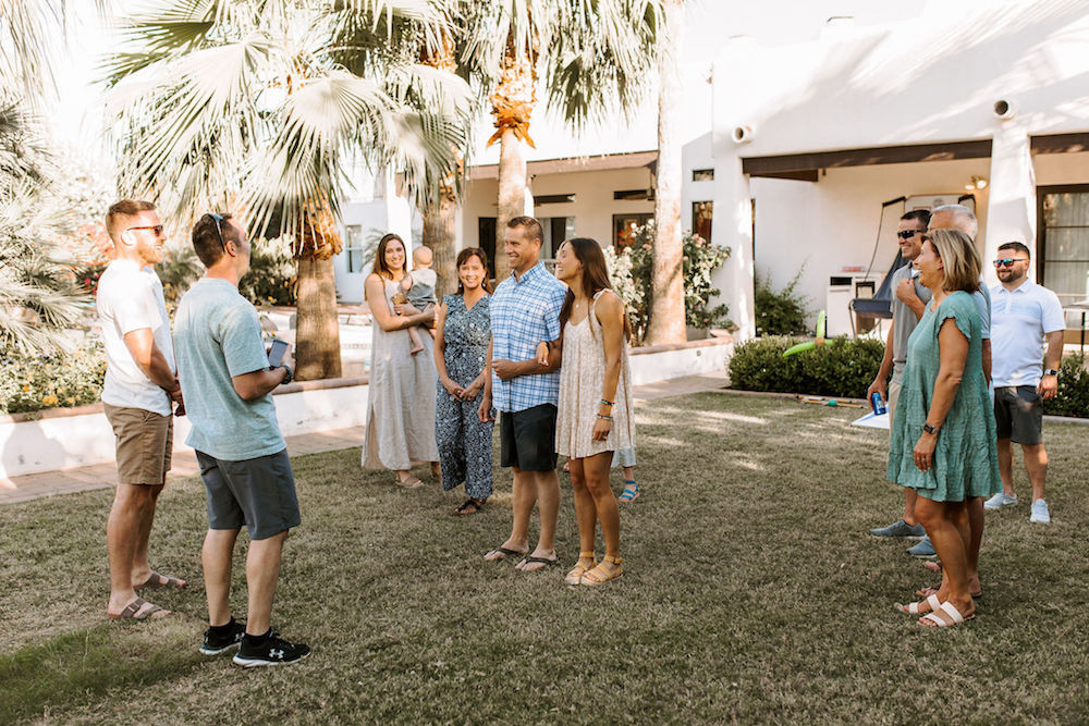 Family standing on the lawn of their Scottsdale, AZ Airbnb for a rehearsal dinner.