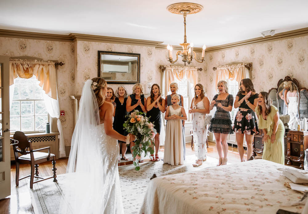 Bride first look with bridesmaids at the Felt Estate in Holland, MI.