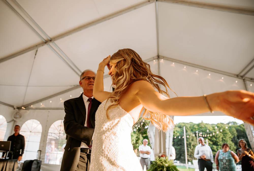 Bride dancing at her wedding at the Felt Estate in Michigan.