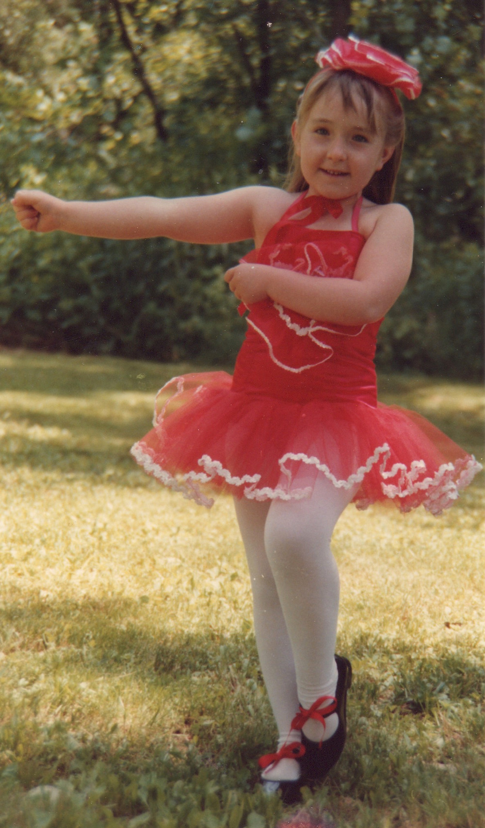 Me in red dance outfit.jpeg