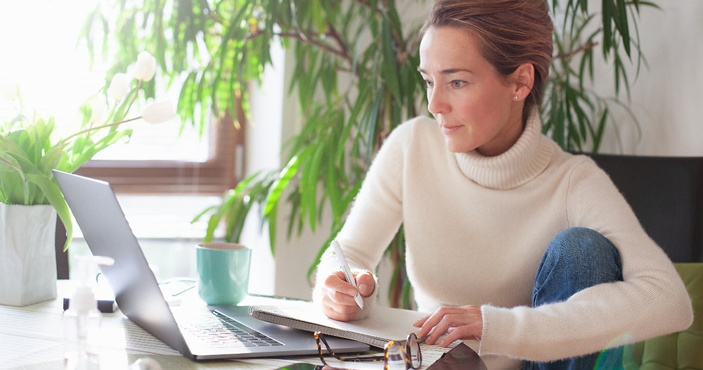 Betterplace - How to find out what your home is worth. Lady researching property prices online.