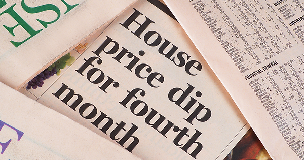 How does negative equity happen? Finance newspaper showing falling house prices.