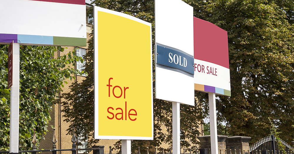 Pros and cons of changing estate agents when selling a house - Estate agent for sale boards