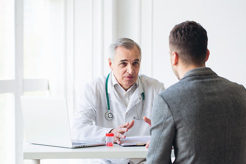 Senior doctor consults young patient.jpg