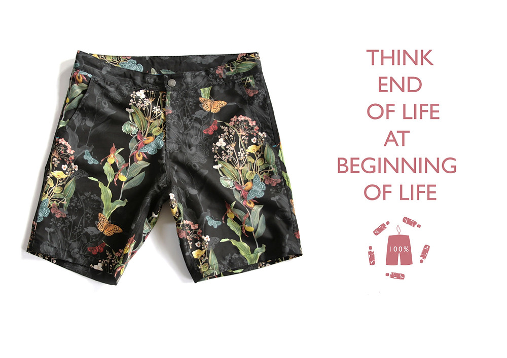 A pair of boardshorts with a quote stating 'Think end of life at beginning of life'.