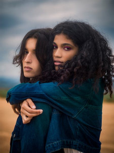 two models looking toward the camera wearing clothes by Away to Mars