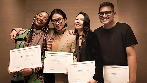 Winners of The Kering Award smiling whil