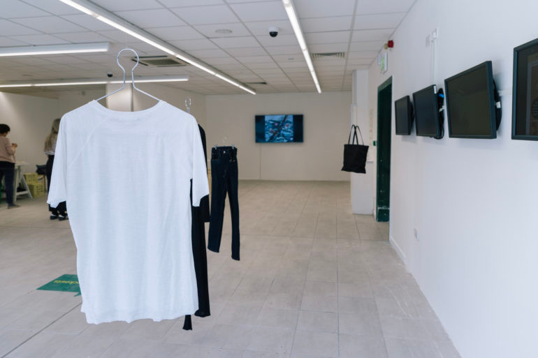 a tshirt hanging in an exhibition space at Fashion Now Fashion Futures 2030