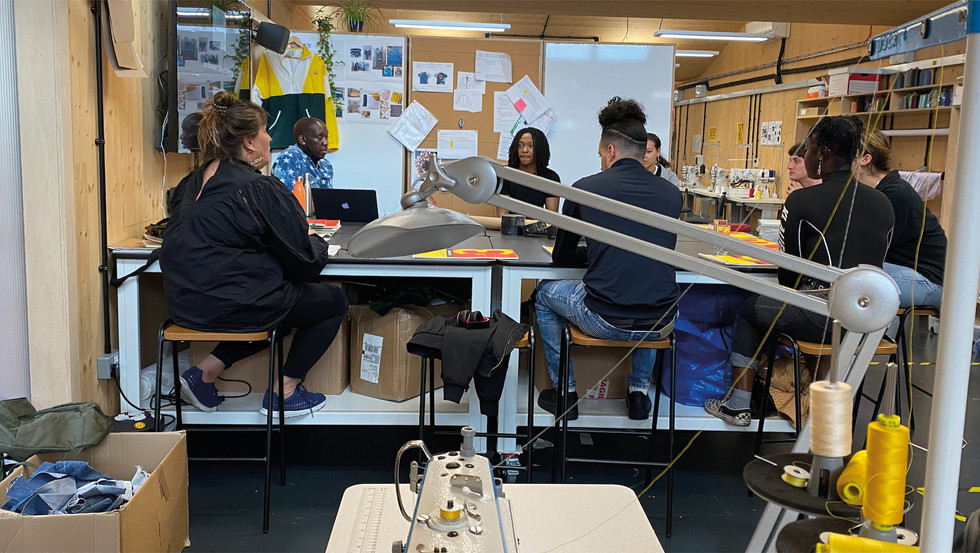 Fashion tutors and ReGo project participants at Poplar Works.